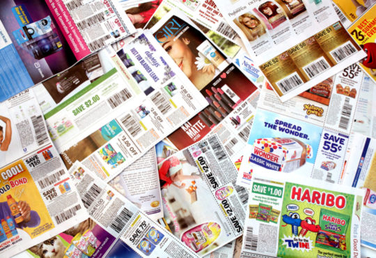 Pile of grocery ads from supermarkets
