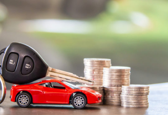 red car and key on stacks of coin, car loan concept,