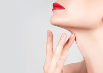 women with red lips touching her neck