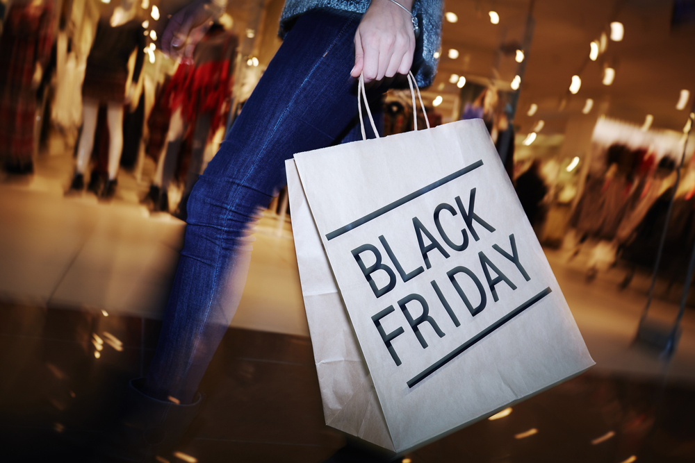 Woman carrying Black Friday shopping bag