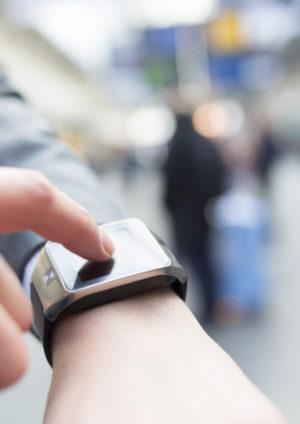 Close up of male hand touching a smart watch on wrist