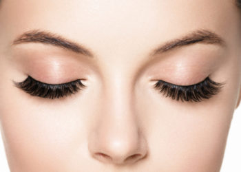 Close up of female face with closed eyes and eyelash extensions