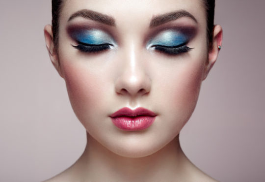 Young beautiful woman with metallic eye shadow on her eyes symbolizing eye make up trends