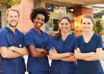 Portrait Of young Medical nurses Standing Outside Hospital