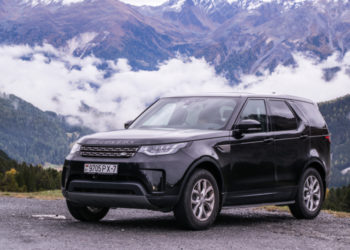 Black Land Rover Discovery 5 in the mountains